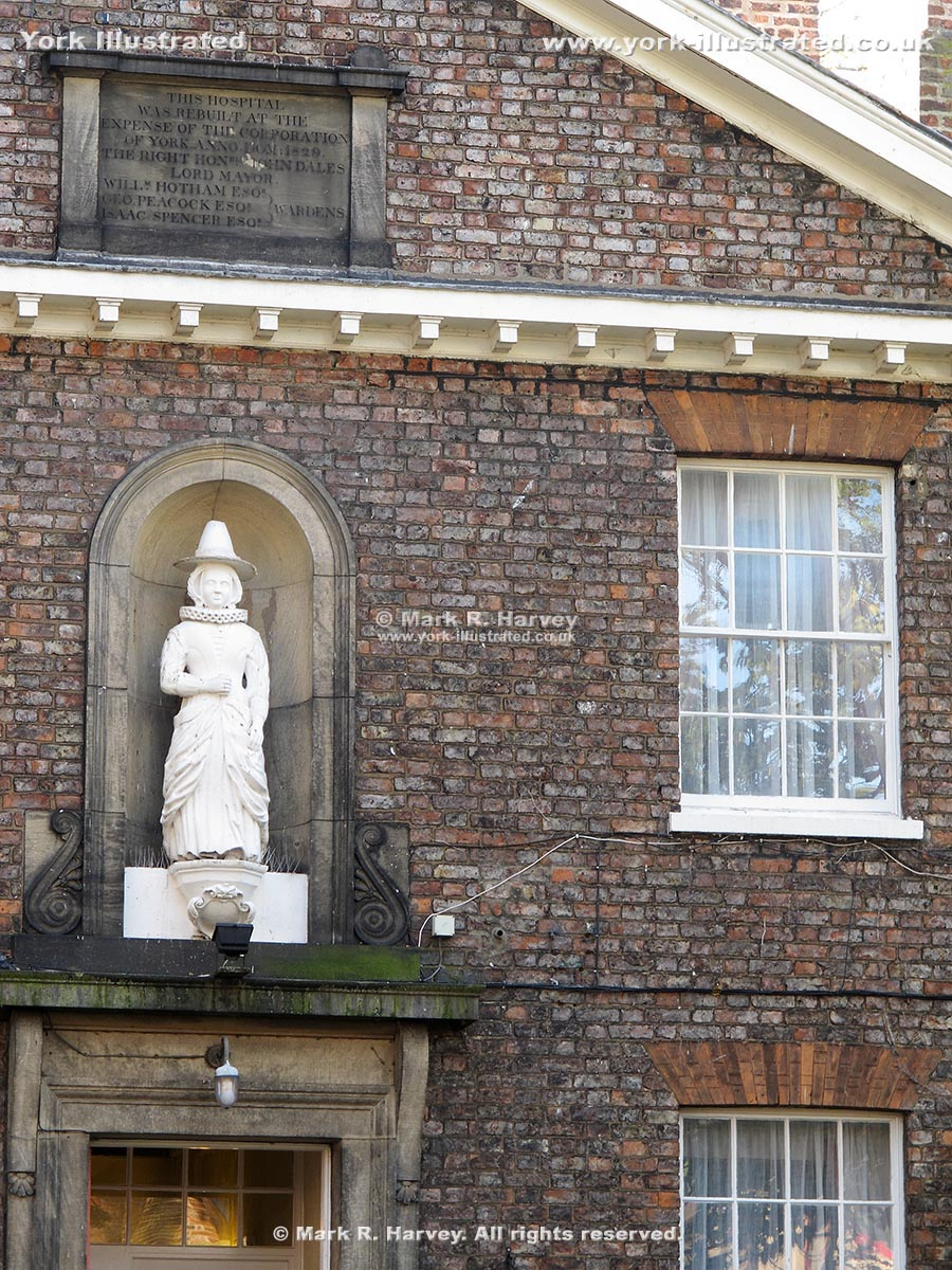 Photo: Commemorative plaque and statue of founder on Anne Middleton's Hospital facade, York.