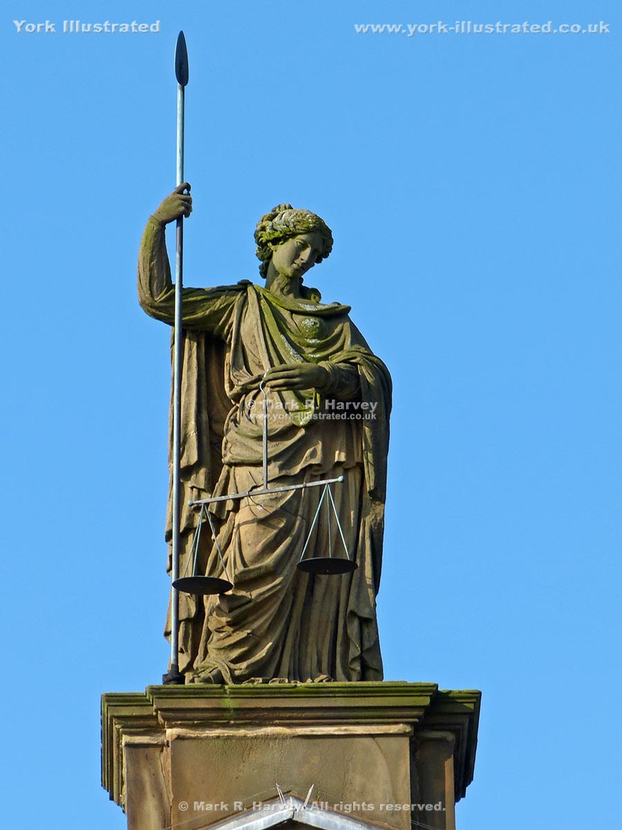 Photograph: Statue of Mother Justice above front facade of Assize Courts Building, York.