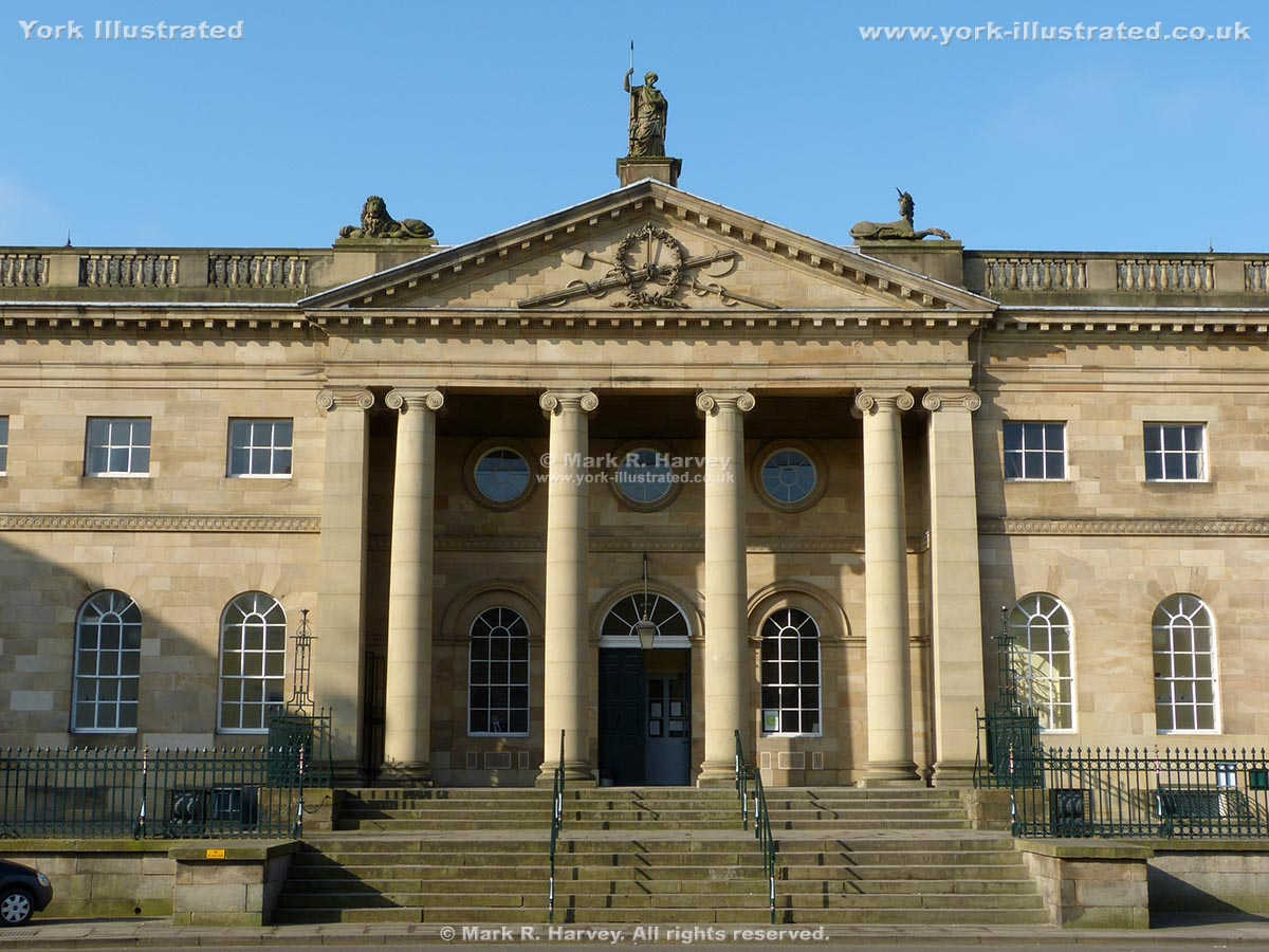 Photograph: The front steps and pedimented portico of York's assize courts building.