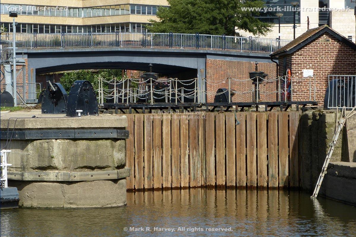 Photograph: Lower lock gates at Castle Mills Lock (York), with Castle Mills Bridge beyond.