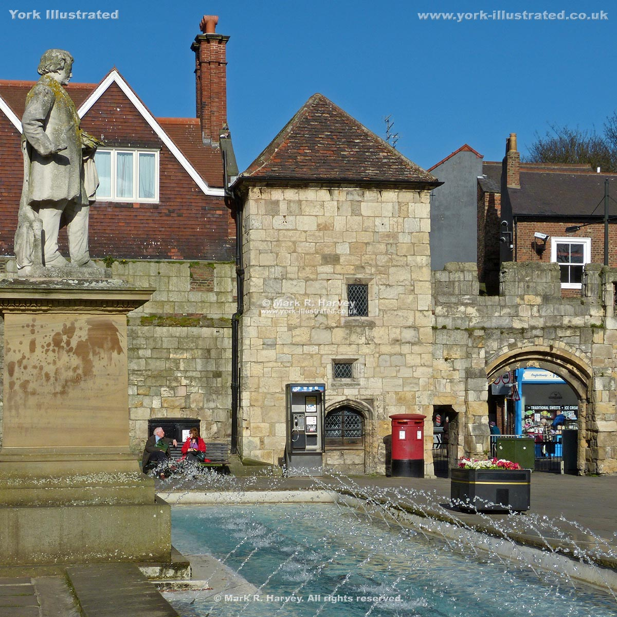 Photograph: Fountains in Exhibition Square (York) with Postern Tower and Queen Margaret's Arch beyond.