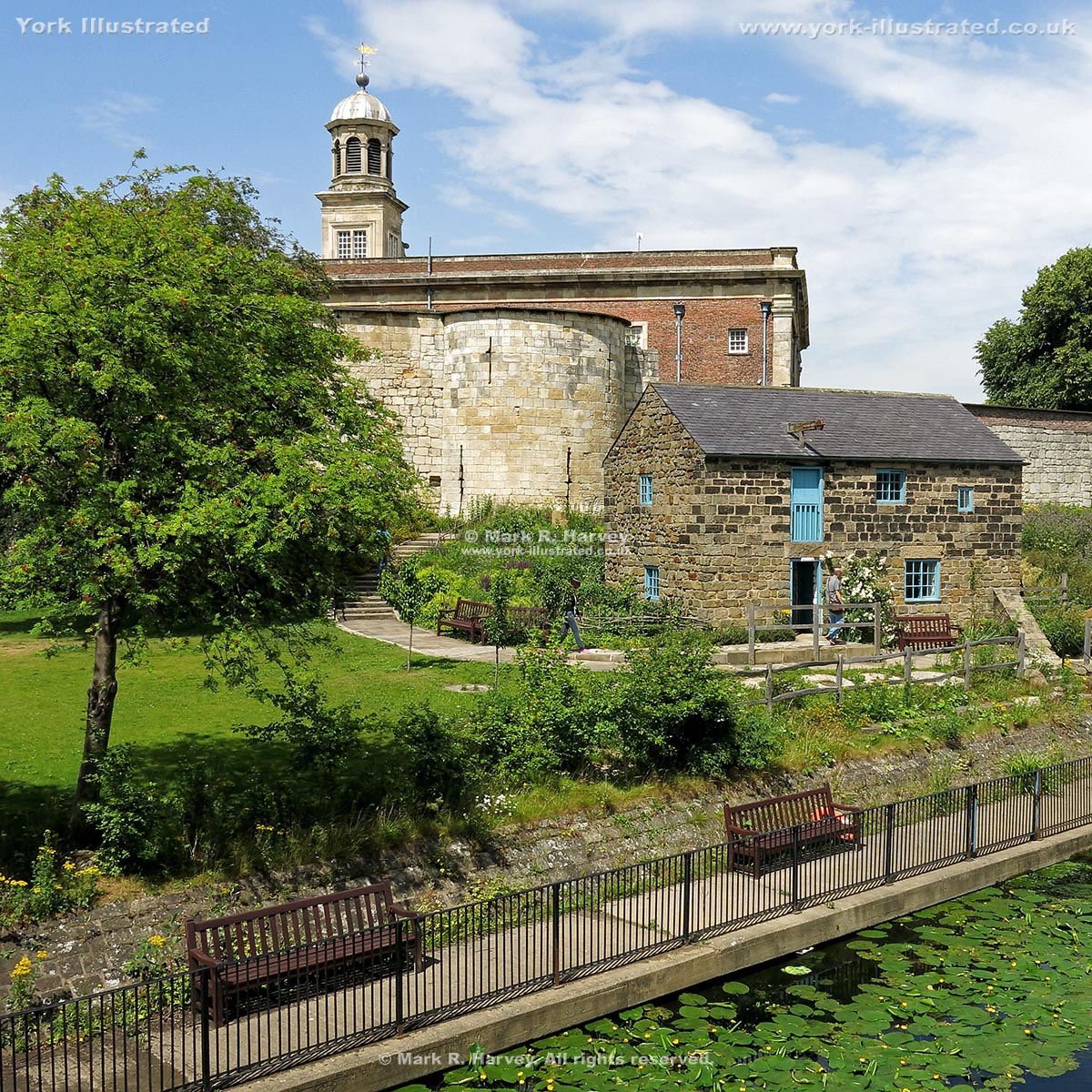 Photograph: Inner bailey walls and southeast tower of York Castle, Raindale Mill, River Foss.
