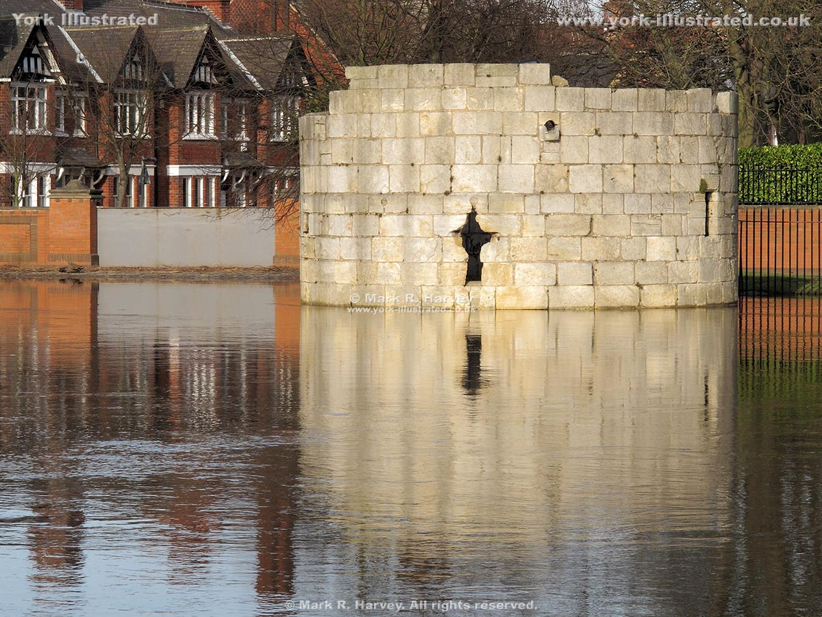 Photograph: River Ouse in flood at Marygate Landing (York). Water Tower immersed to 1st floor level.