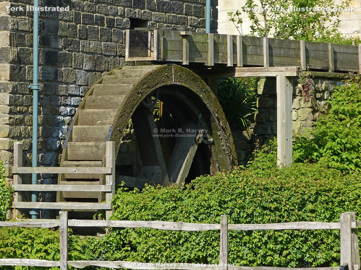 Photograph: overshot waterwheel attached to the northeast elevation of Raindale Mill (York).