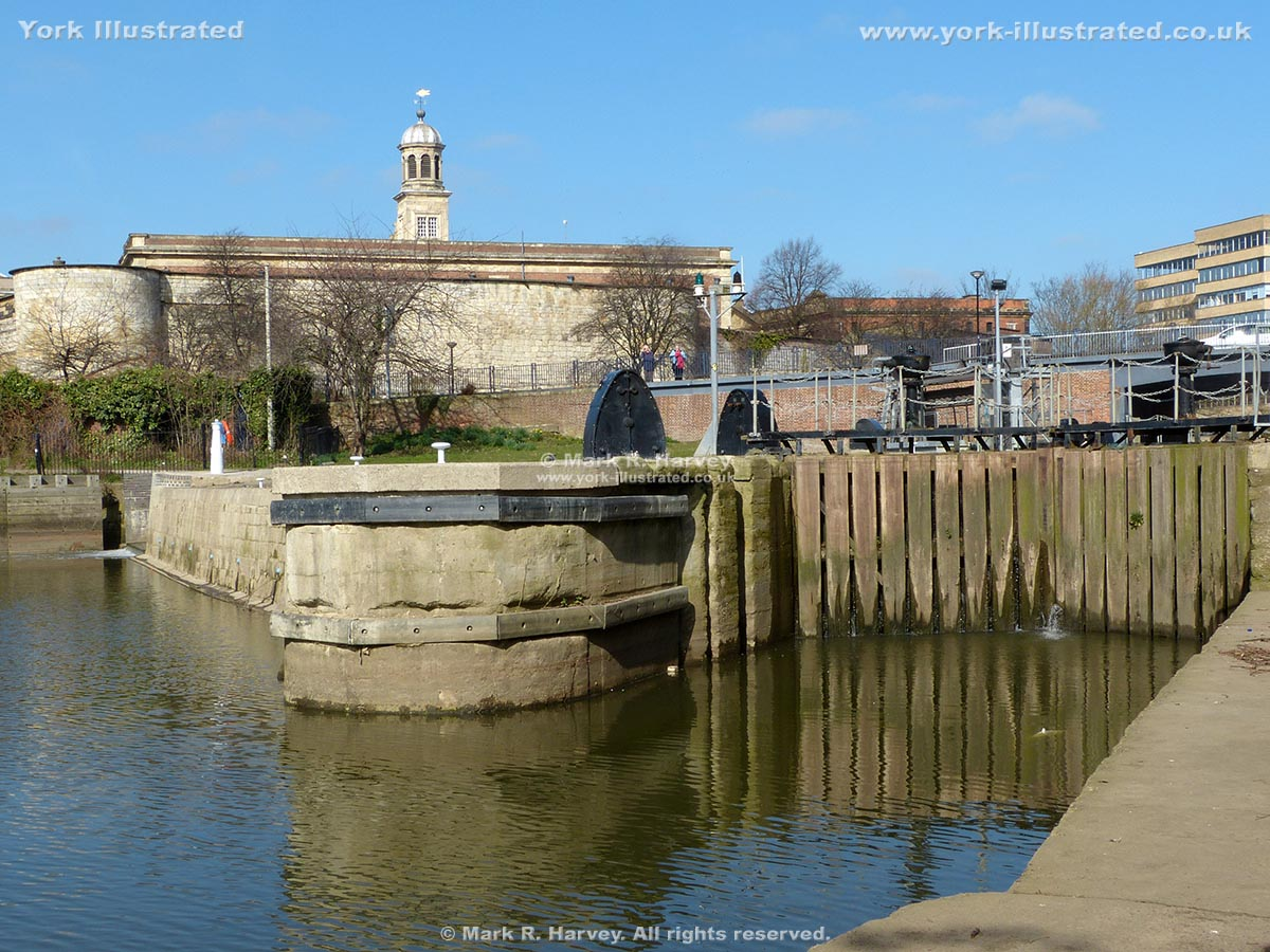 Photograph: Foss Basin & Castle Mills Lock, with the inner bailey wall of York Castle beyond.